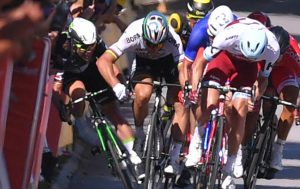 British cyclist Mark Cavendish receiving an elbow from Peter Sagan that causes a crash and a broken shoulder for Cavendish.